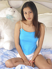 Thai teen gets naked with her fluffy teddy bear