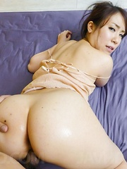 Sakura Ooba Asian with big oiled behind is screwed in dark pussy