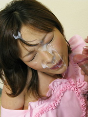 While on her knees Yui Ayana is cumed onto.