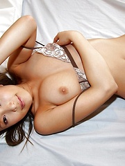 Yua Aida sexy Asian model shows off her firm tits